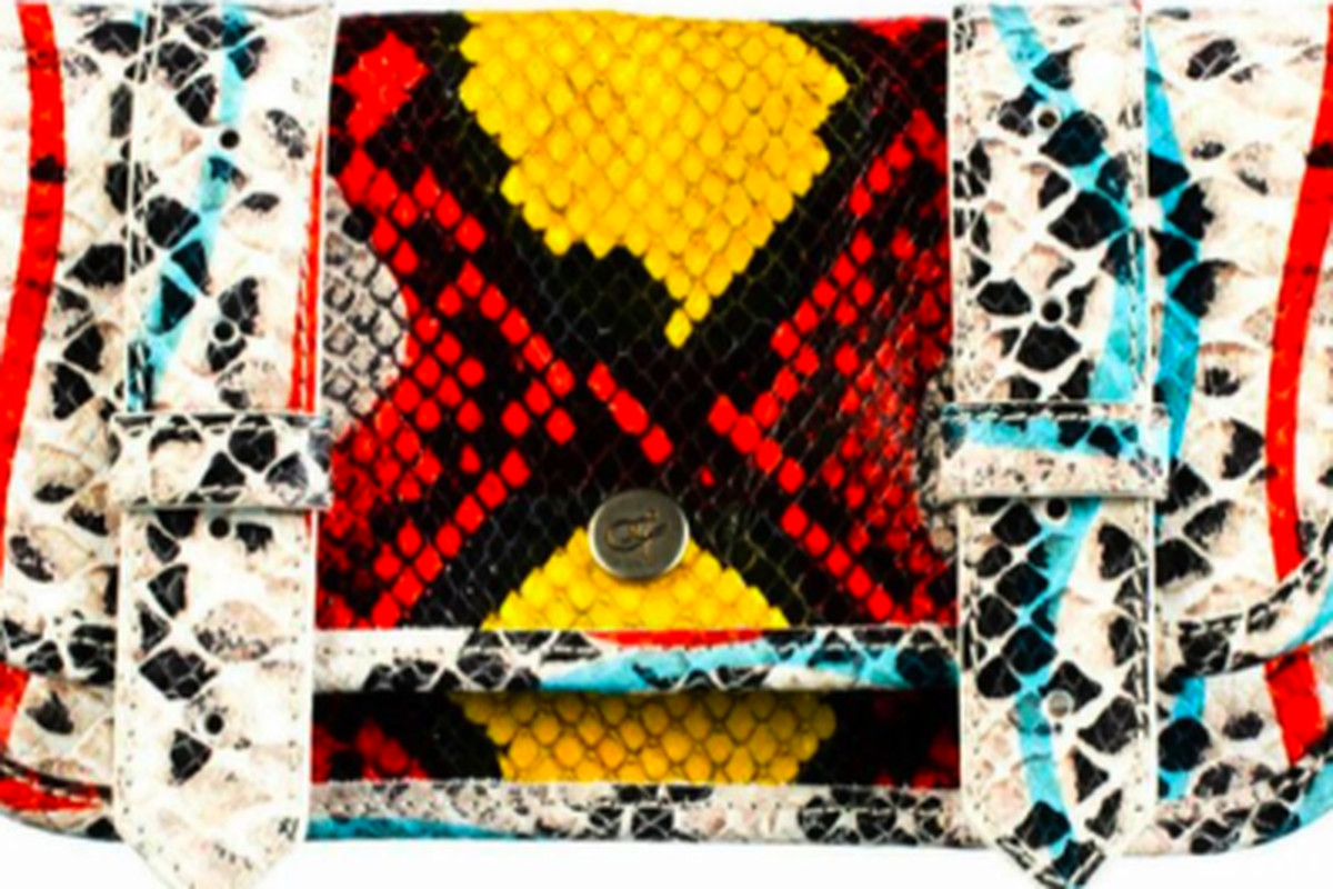 """The special edition printed python wallet, <a href=""""http://www.proenzaschouler.com/shop/new-arrivals/ps1-wallet-printed-python-1.html?color=Printed+Python"""">$165</a>"""