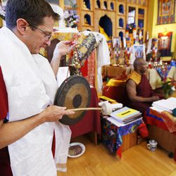 Jay Moreland hits a gong as members of the Tibetan Buddhist Temple participate in annual Prayers for Compassion celebrations in Salt Lake City Thursday, July 3, 2014. The three-day festival offers members of the Salt Lake community a chance to observe, support and participate in a beautiful round-the-clock ritual generating compassion and loving-kindness on behalf of all sentient beings.
