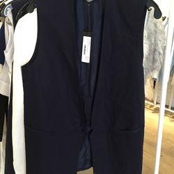 Lapel vest in navy, $220 (originally $665)