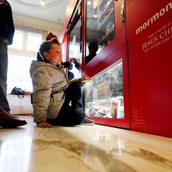Hudson Ryan looks into a Light the World charity vending machine at to the Joseph Smith Memorial Building in Salt Lake City on Friday, Dec. 15, 2017.