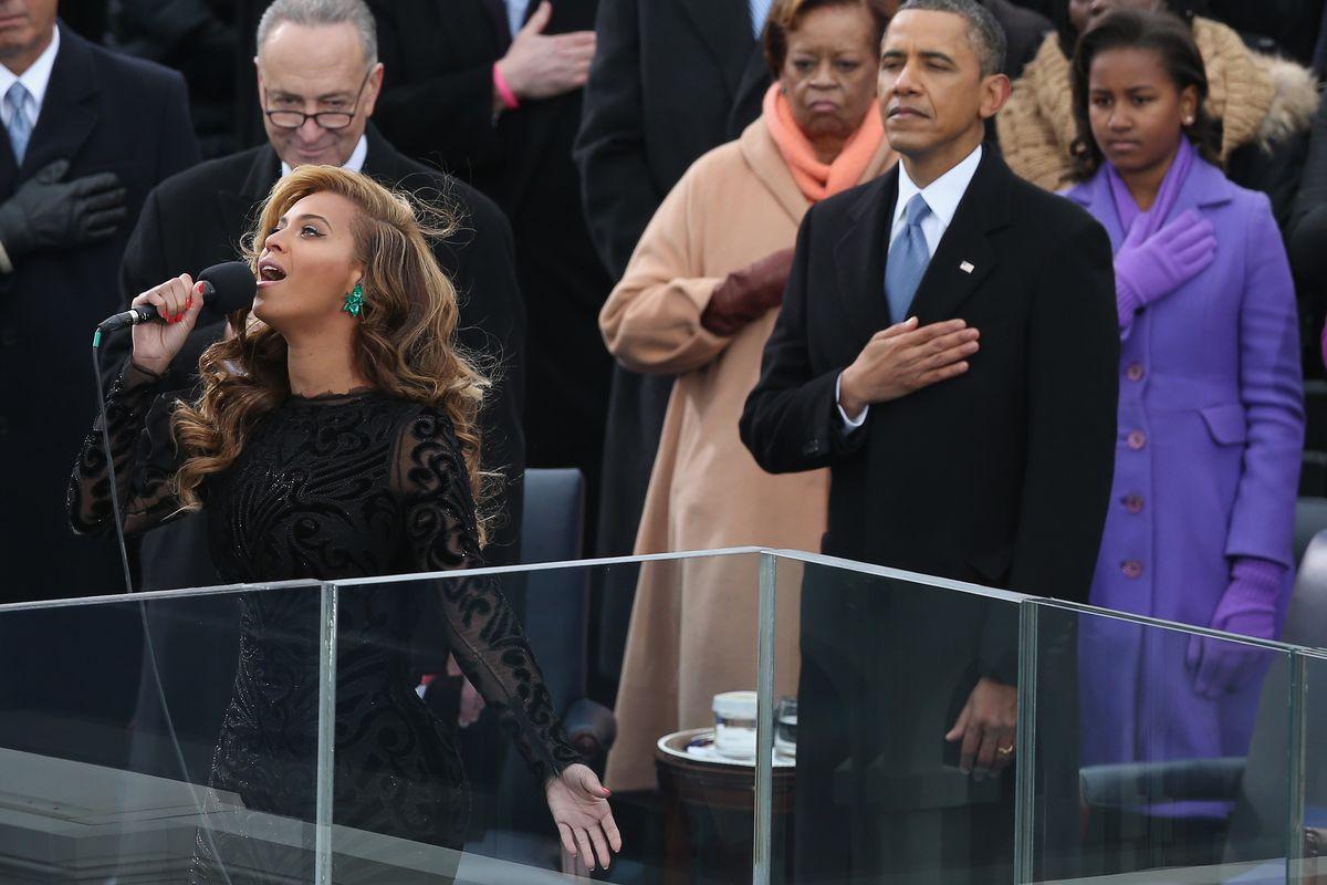 President Barack Obama listens to Beyonce.