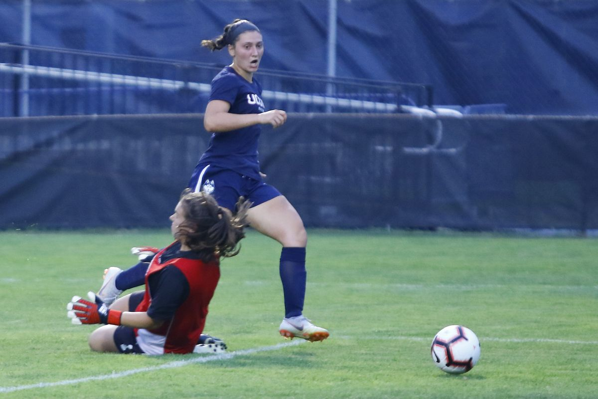 UConn's Sophia Danyko-Kulchycky (23) slips it past the Sacred Heart goalkeeper for her first of two goals on the night.