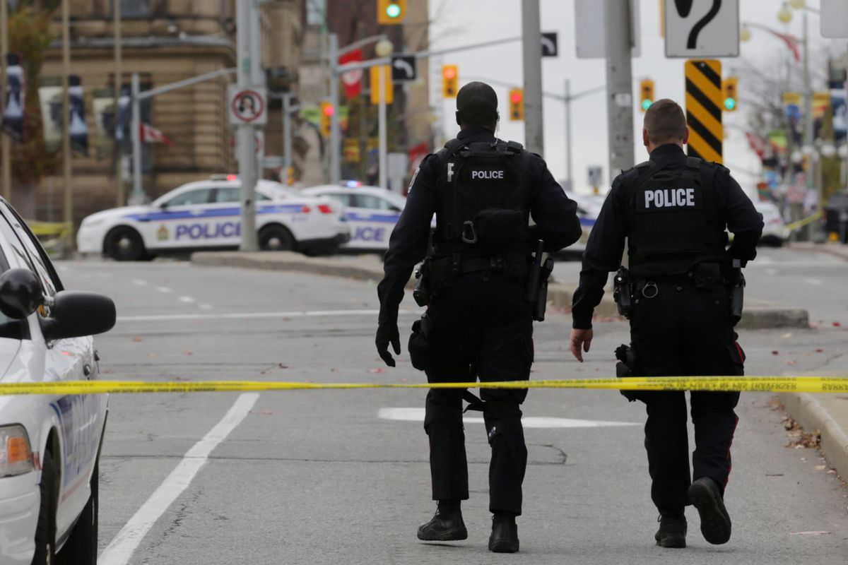 Police officers responding to the shooting on Ottawa's Parliament Hill