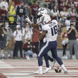 Utah State wide receiver Deven Thompkins, left, celebrates his touchdown with wide receiver Brandon Bowling during the second half of an NCAA college football game against Washington State, Saturday, Sept. 4, 2021, in Pullman, Wash. Utah State won 26-23.