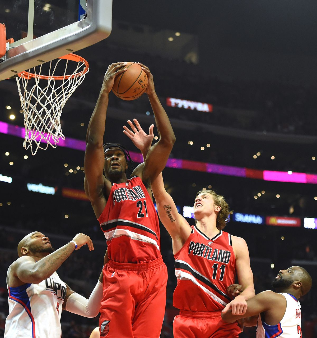 Noah Vonleh of the Portland Trail Blazers grabs a rebound from Meyers Leonard and Marries Speights and Raymond Felton of the Los Angeles Clippers.