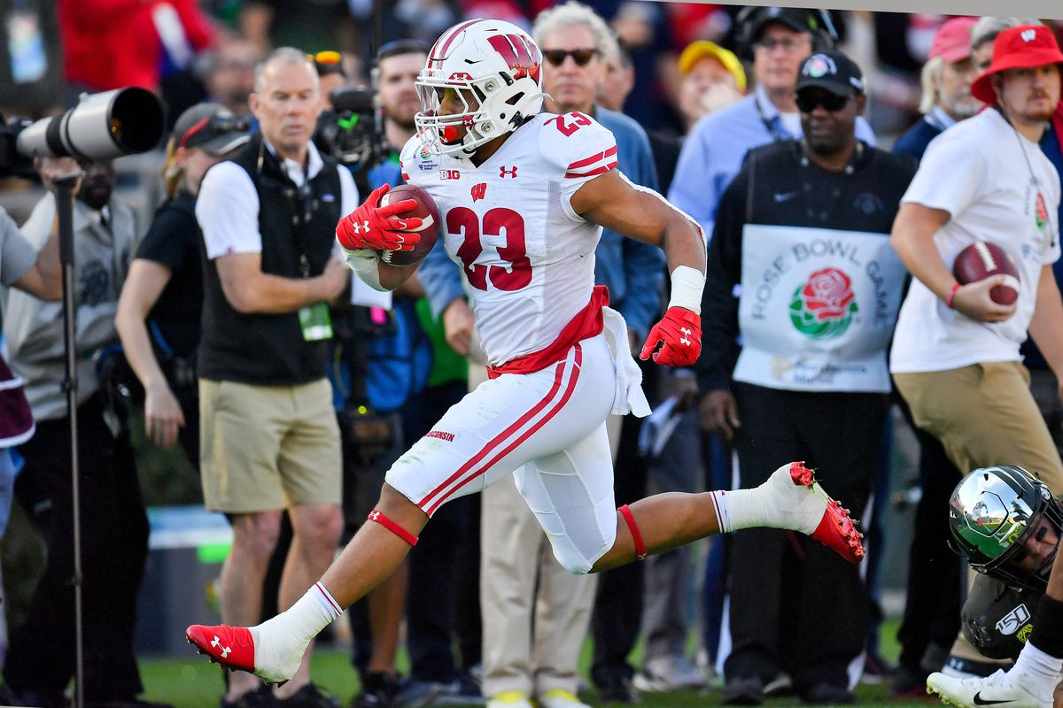 Jonathan Taylor of the Wisconsin Badgers runs for a 10 yard gain during the second quarter of the game against the Oregon Ducks at the Rose Bowl on January 01, 2020 in Pasadena, California. The Oregon Ducks topped the Wisconsin Badgers, 28-27.