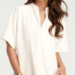 """<a href=""""http://www.anntaylor.com/ann/product/AT-Petites/AT-Petite-Blouses-Tops/Petite-Poetic-Tunic/277588?colorExplode=false&skuId=10664735&catid=cata000045&productPageType=saleProducts&defaultColor=9192"""">Petite Poetic Tunic</a>, $34.99 (was $49.88)"""