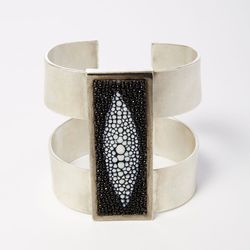"""Sterling silver and shagreen cuff, <a href=""""http://personastyle.com/collections/joseph-gordon-cleveland/products/sterling-silver-and-shagreen-cuff-by-joseph-gordon-cleveland"""">$4,885</a>"""