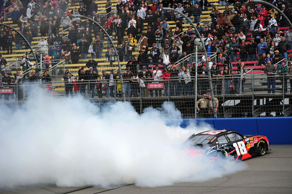 Kyle Busch performs a burnout after winning the NASCAR Nationwide Series Royal Purple 300 at Auto Club Speedway.