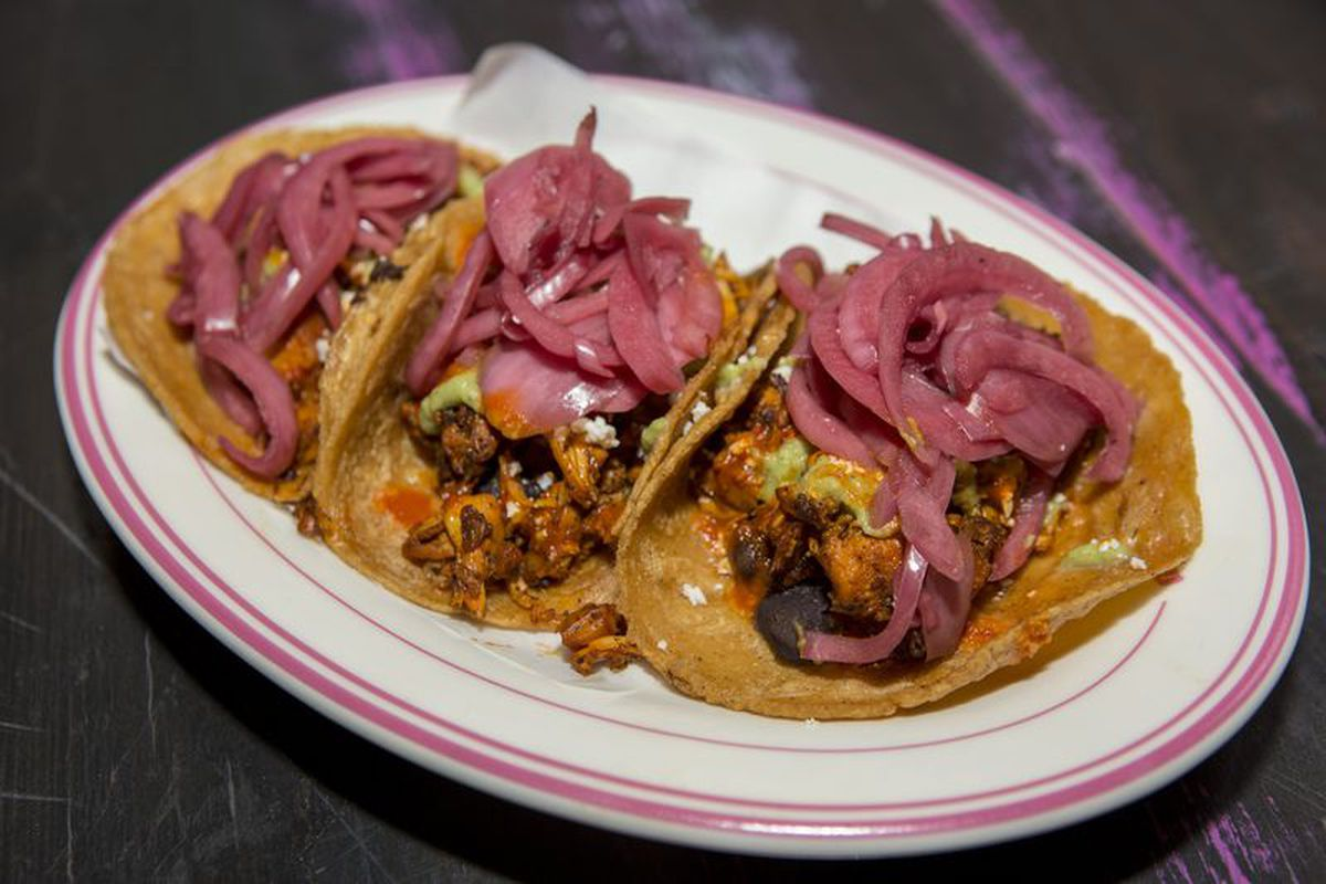 An order of tacos topped with pickled red onion at Pink Taco's Chicago location