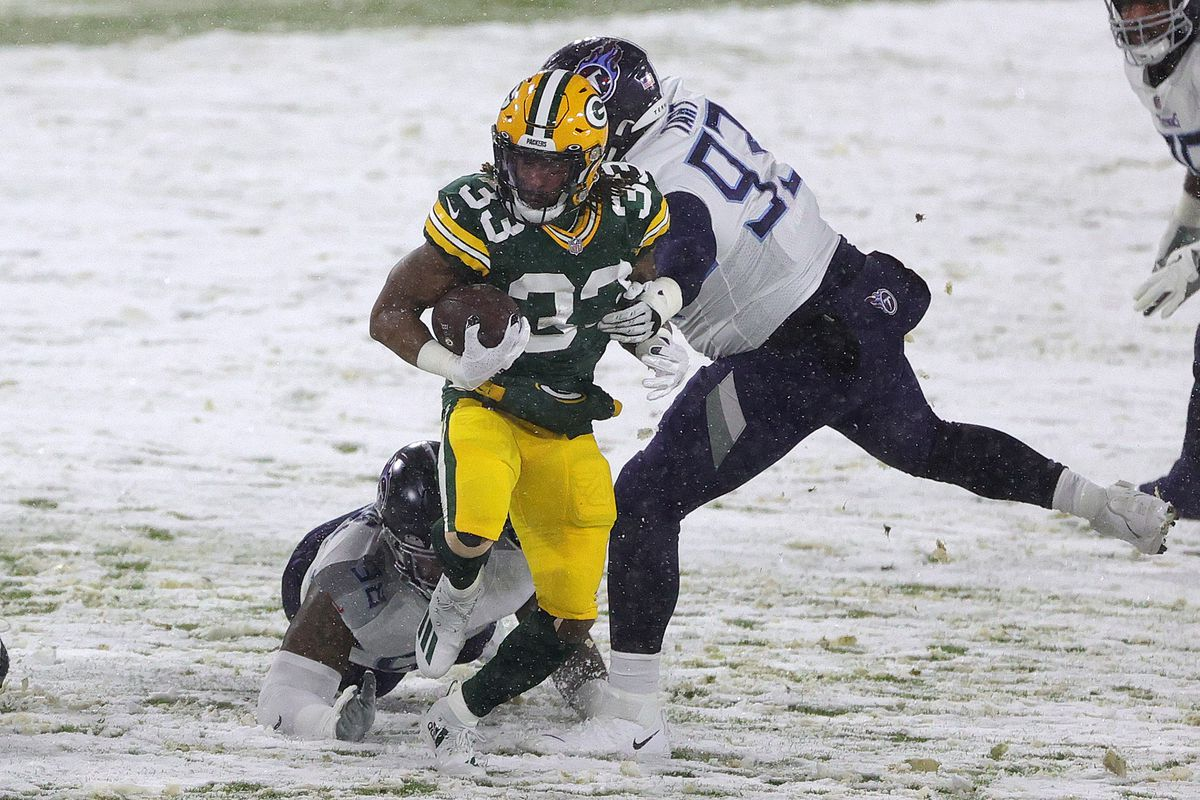 Running back Aaron Jones #33 of the Green Bay Packers runs against the Tennessee Titans during the first quarter at Lambeau Field on December 27, 2020 in Green Bay, Wisconsin.