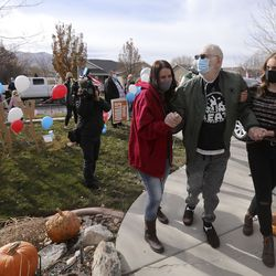 Vietnam veteran Warren Craig Eby, center, is assisted by daughter Alissa Allen, left, and granddaughter Storme Cooper, right, during a welcome home celebration in Saratoga Springs on Friday, Nov. 13, 2020. Eby was hospitalized for seven weeks with COVID-19