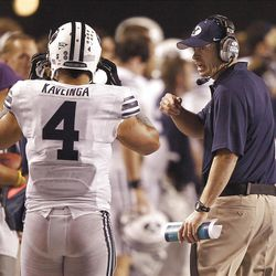 Head coach Bronco Mendenhall of the Brigham Young Cougars talks with Uona Kaveinga of the Brigham Young Cougars during NCAA football in Boise, Thursday, Sept. 20, 2012.