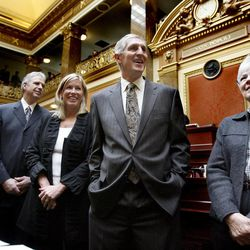 Recently retired Jazz coaches Jerry Sloan and Phil Johnson are honored in the House of Representatives at the Utah State Capitol on March 7, 2011.  From right to left, Gail Miller, Jerry Sloan, Sloan's wife Tammy Sloan and Phil Johnson enjoy the comments made by the legislators.
