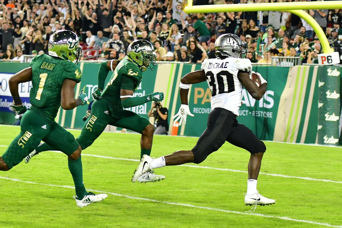 Greg McCrae runs for a touchdown as two South Florida Bulls chase after him