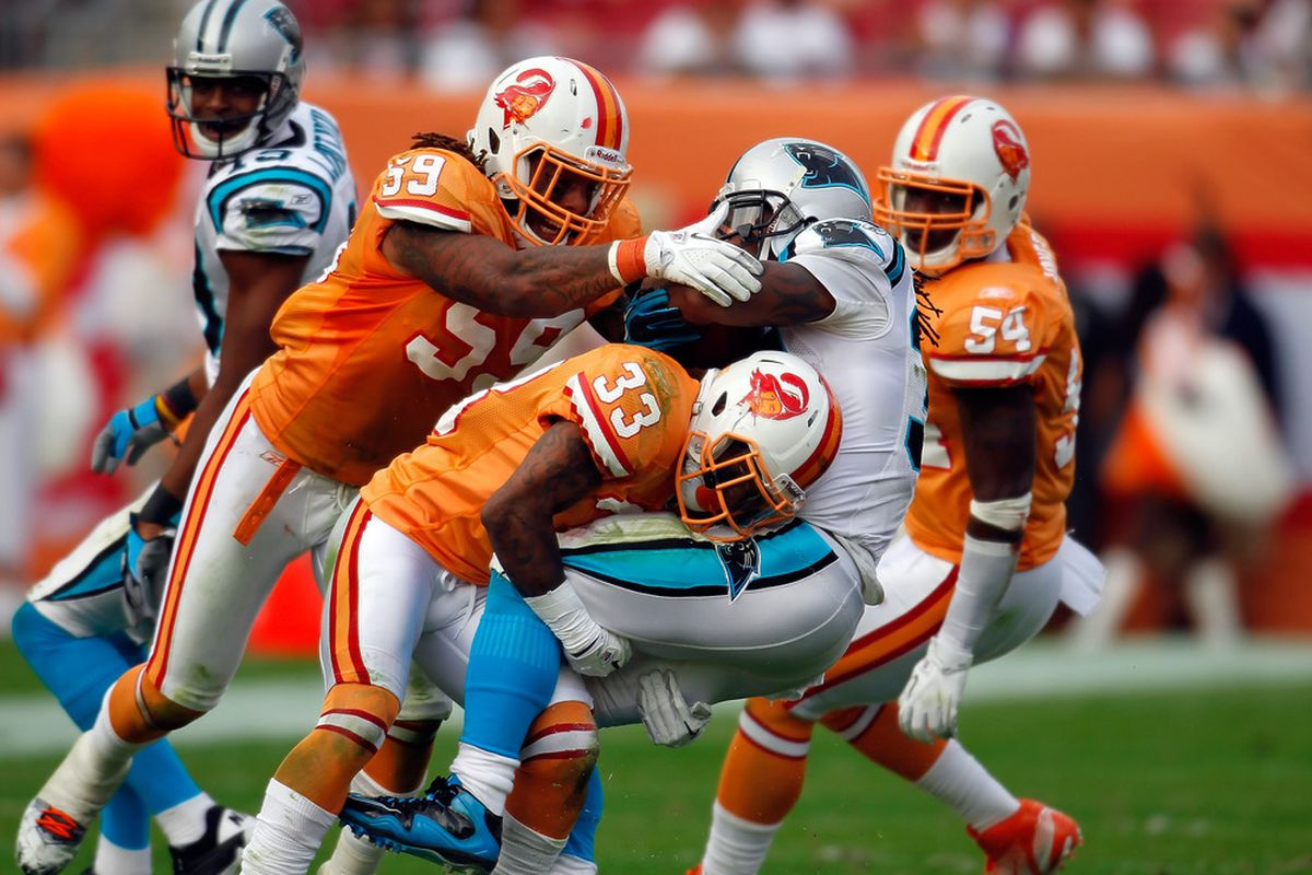 I want to see a lot of this occurring near the line of scrimmage today.  (Photo by J. Meric/Getty Images)