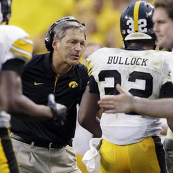 Iowa head coach Kirk Ferentz celebrates with running back Andre Dawson (32) after Dawson scored a touchdown during the second half of an NCAA college football game against Northern Illinois at Soldier Field in Chicago, Saturday, Sept. 1, 2012. Iowa won 18-17.