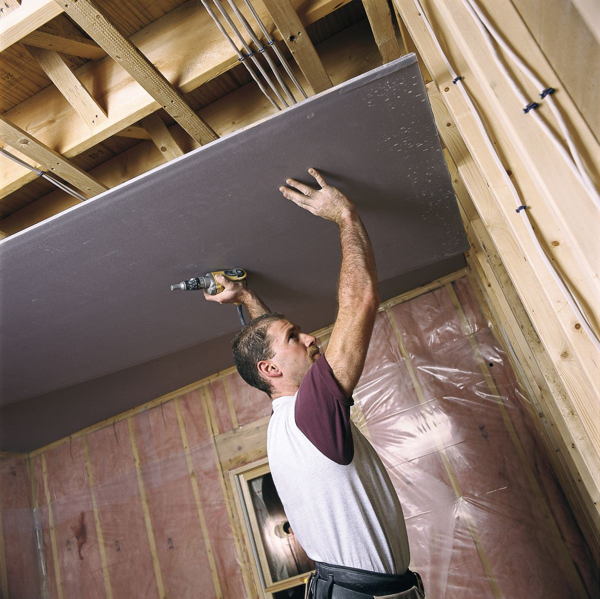 Man Covers Ceiling For Drywall