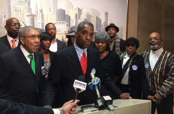 David Moore is shown before his election last year at a City Hall news conference called to respond to a smear campaign being waged against him. To Moore's left is 90-year-old Rev. Clay Evans,<br>former founding national chairman of Operation PUSH and fou