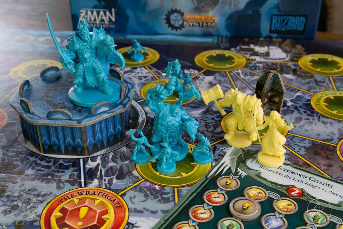 Miniatures from World of Warcraft, a Pandemic System game, including two heroes, some Scourge (blue) and the big bad himself.