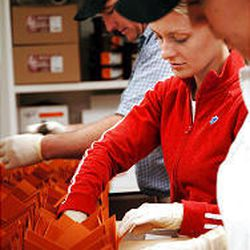 Master chocolatier Ronald Best, in the background, distribution supervisor Emily Branch, center, and employee Norma Villegas pack toffee boxes in their factory, located at 3590 S. Via Terra in Salt Lake City.