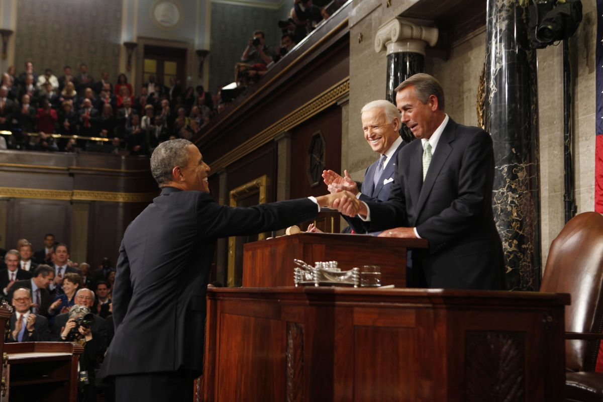 President Barack Obama shakes hands with Speaker of the House John Boehner at the 2014 State of the Union.