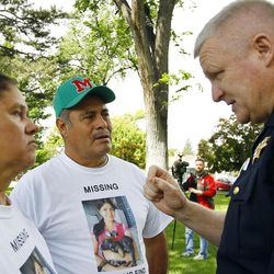 Provo Police Chief John King speaks to the parents of Elizabeth Salgado before a march to find Salgado in Provo, Saturday, May 23, 2015.