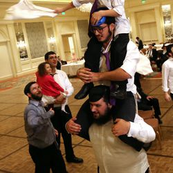 Men and boys dance at Chaya Zippel and Rabbi Mendy Cohen's traditional Hasidic wedding at the Grand America Hotel in Salt Lake City on Monday, Sept. 12, 2016.