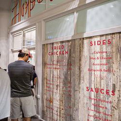 Check out the menu for Hop's Chicken while standing in line to order.
