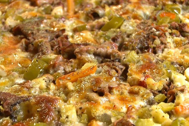 Sausage and giardiniera thin crust pizza.