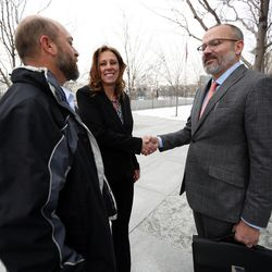 Lee Garcia and Kelly Janis talk to Stewart Gollan, an attorney with the Pioneer Justice Center, outside the federal courthouse in Salt Lake City on Wednesday, Feb. 1, 2017. Gollan is representing Kathleen Janis, a ninth-grade student at Central Davis Junior High, who is suing the Davis School District because she isn't allowed to participate in her school's wrestling program.