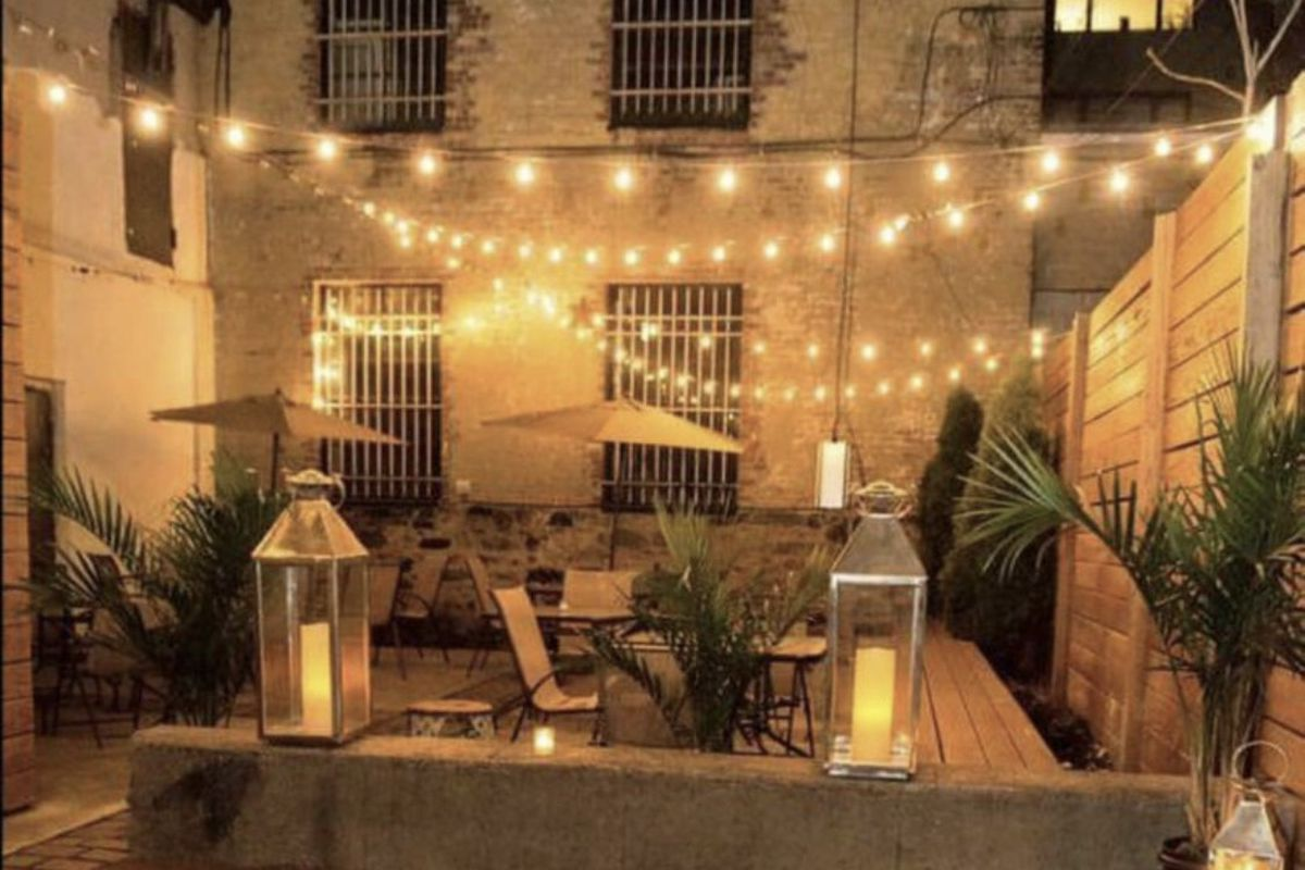 The backyard of the gay bar the Rosemont with fairy lights and lanterns