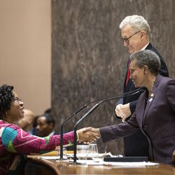 City Treasurer Melissa Conyears-Ervin shakes hands with Mayor Lori Lightfoot following adjournment of their first Chicago City Council meeting at City Hall, Wednesday, May 29, 2019.
