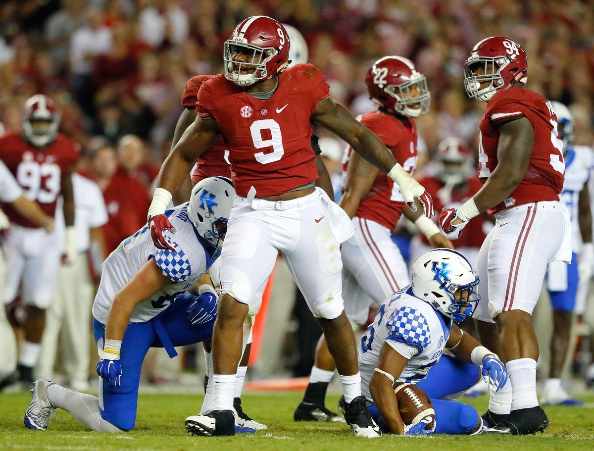 TUSCALOOSA, AL:  Alabama Crimson Tide defensive lineman Da'Shawn Hand (9) celebrates a tackle for loss of yards against Kentucky Wildcats running back Benjamin Snell Jr (26) at Bryant-Denny Stadium.