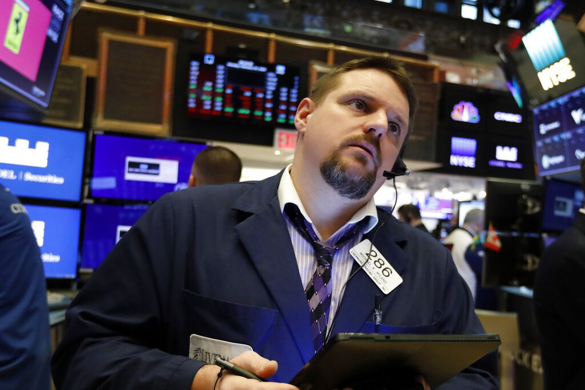 Photo trader Michael Milano works on the floor of the New York Stock Exchange.