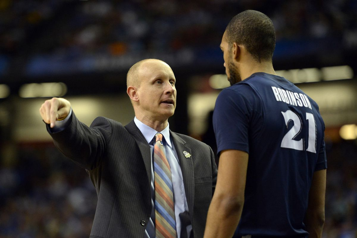 Coach Mack explains to Jeff Robinson that the games will only be contested on the one end of the floor this season.