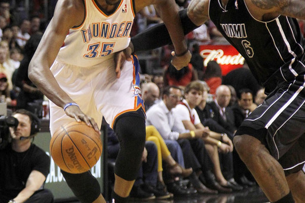 April 4, 2012; Miami, FL, USA; Oklahoma City Thunder small forward Kevin Durant (35) dribbles the ball against Miami Heat small forward LeBron James (6) in the first period at the American Airlines Arena. Mandatory Credit: Robert Mayer-US PRESSWIRE