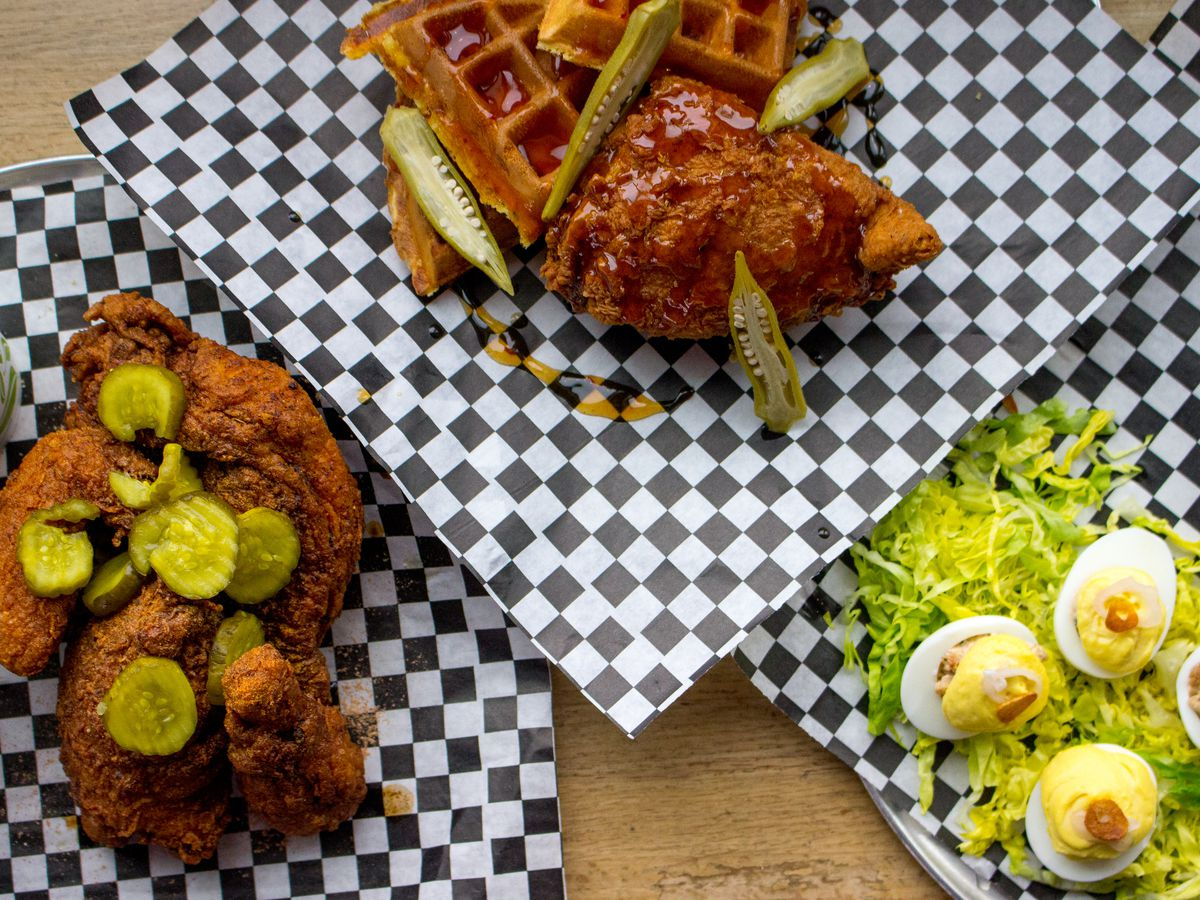 Fried chicken with sides, waffles, and deviled eggs