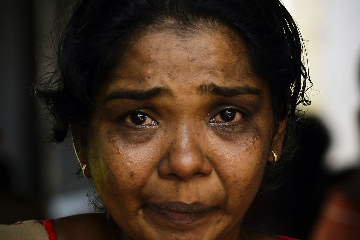 A Sri Lankan relative of a bomb blast victim weeps at a morgue in Colombo.