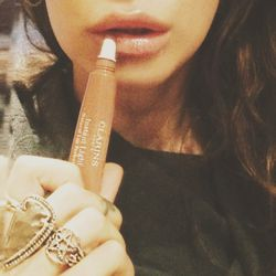 I've been raving about this lip gloss from <b>Clarins</b> for months now—I love the nude colors and how they really do plump your lips without being too sticky or feeling heavy.  It is the most important product in my makeup bag. Also, they smell amazing.