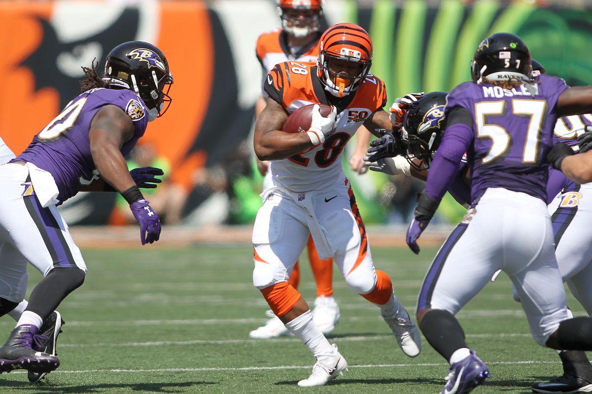 Joe Mixon carries the ball against the Baltimore Ravens