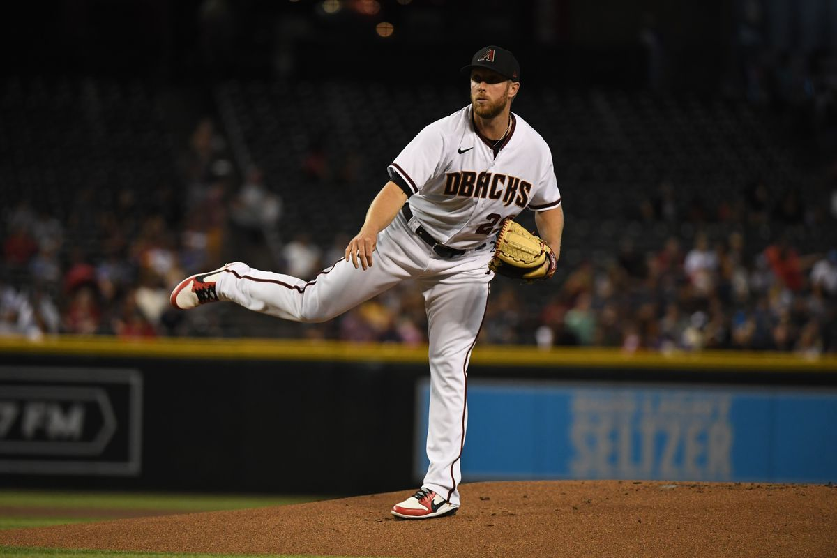 Merrill Kelly #29 of the Arizona Diamondbacks delivers a pitch against the Milwaukee Brewers at Chase Field on June 21, 2021 in Phoenix, Arizona.