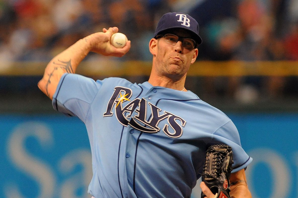 ST. PETERSBURG, FL - JULY 22:  Pitcher Kyle Farnsworth #43 of the Tampa Bay Rays throws in relief against the Seattle Mariners July 22, 2012 at Tropicana Field in St. Petersburg, Florida.  Seattle won 2 - 1. (Photo by Al Messerschmidt/Getty Images)