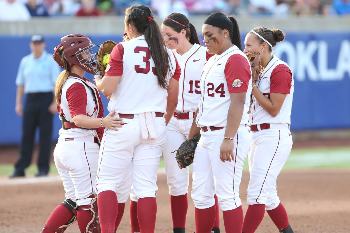 Jackie Traina and Co. huddle in last seasons WCWS in Stillwater.