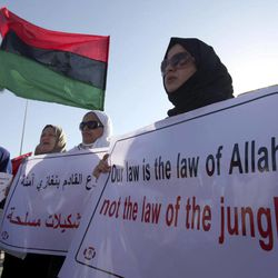 Libyan women protest against Ansar al-Shariah Brigades and other Islamic militias in front of the Tebesty Hotel, in Benghazi, Libya, Friday, Sept. 21, 2012. The attack that killed the U.S. ambassador and three other Americans has sparked a backlash among frustrated Libyans against the heavily armed gunmen, including Islamic extremists, who run rampant in their cities. More than 10,000 people poured into a main boulevard of Benghazi, demanding that militias disband as the public tries to do what Libya's weak central government has been unable to.