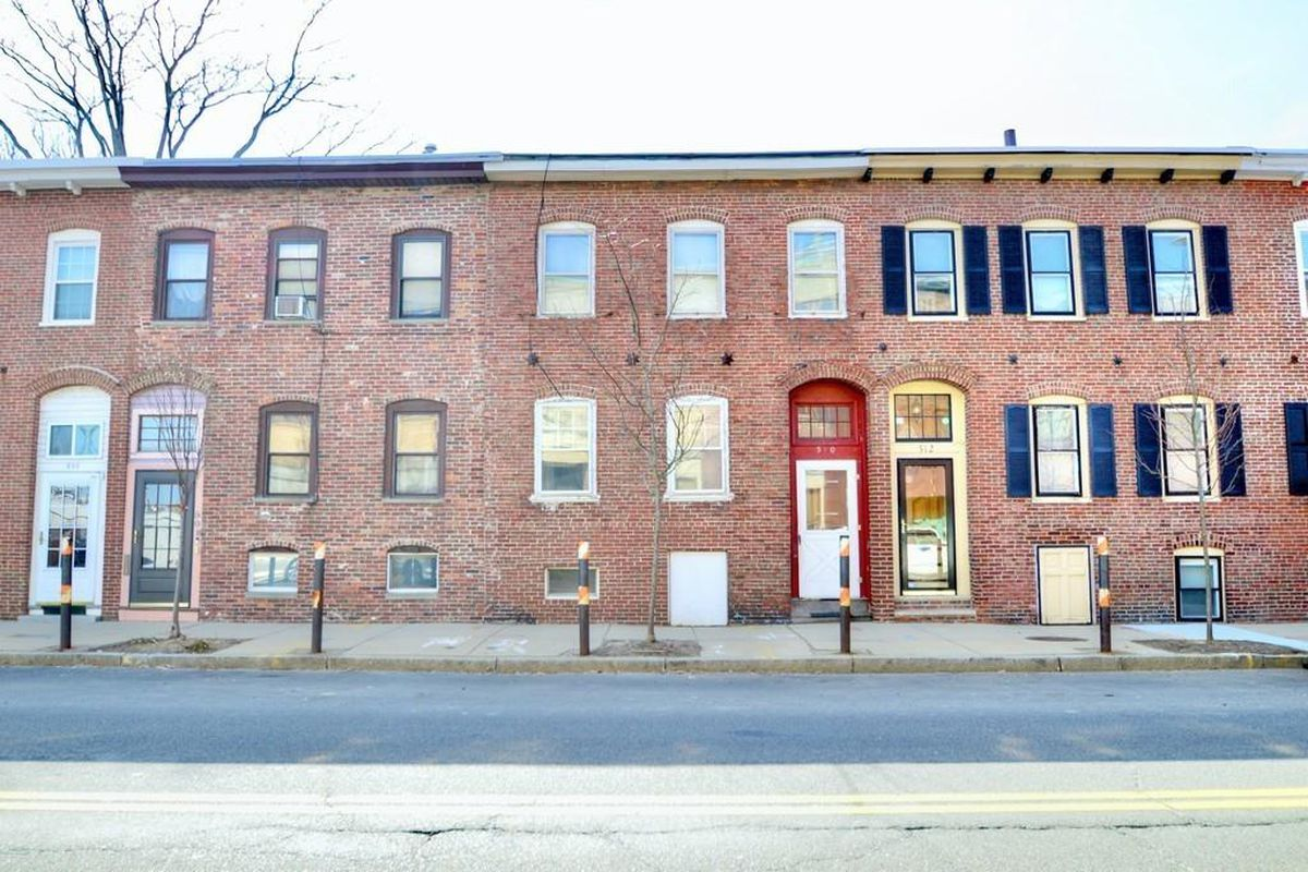 A row of two-story brick houses.