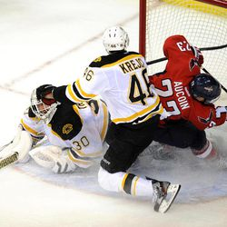 Washington Capitals center Keith Aucoin (23) goes to the net against Boston Bruins goalie Tim Thomas (30) and David Krejci (46), of the Czech Republic, during the second period of Game 6 of an NHL hockey Stanley Cup first-round playoff series, Sunday, April 22, 2012, in Washington.