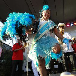 Jennifer Jones dances with the Treme Brass band at a sunrise concert marking International Jazz Day in New Orleans, Monday, April 30, 2012. The performance, at Congo Square near the French Quarter, is one of two in the United States that day; the other is in the evening in New York. Thousands of people across the globe are expected to participate in International Jazz Day, including events in Belgium, France, Brazil, Algeria and Russia.
