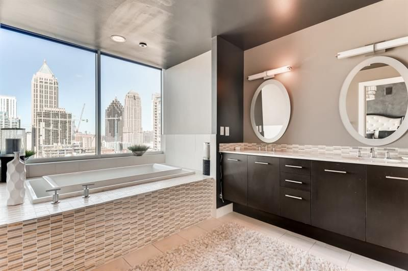 A huge master bathroom with city views.