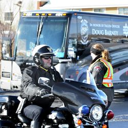 Officers arrive at the funeral of Unified police officer Doug Barney at the Maverik Center in West Valley City on Monday, Jan. 25, 2016. Barney was killed in the line of duty on Jan. 17, 2016.